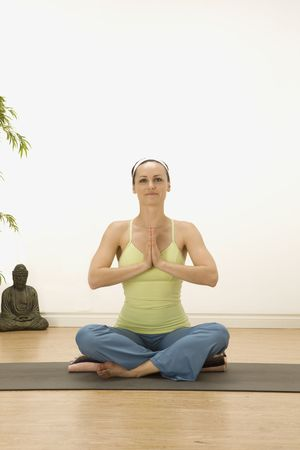 woman in a traditional yoga pose Stock Photo - 5388369