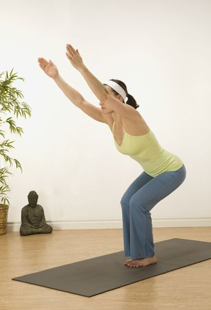 woman in a traditional yoga pose  Stock Photo