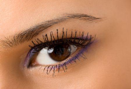 bloodshot: female wide open brown eye with long eyelashes macro