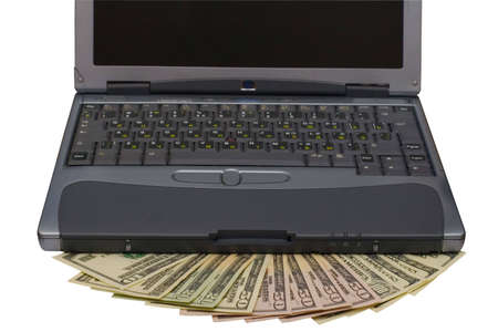 Computer and money with clipping path photo