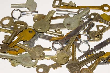 the many old keys on white background