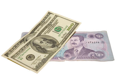 plunder: US dollars banknotes over iraq dinars with clipping path