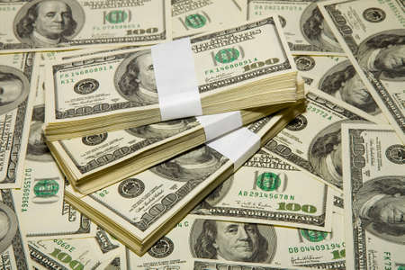 the thousands US dollars heap on dollars background