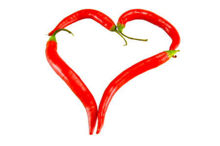 the heart figure from chili peppers on white background photo