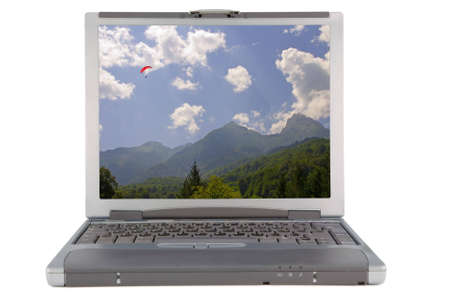the laptop witn nature background isolated with clipping path photo