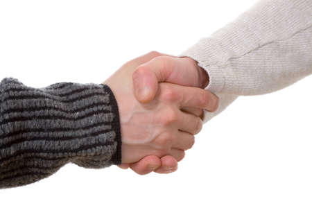 assent: the handshake of two mens hands on white background