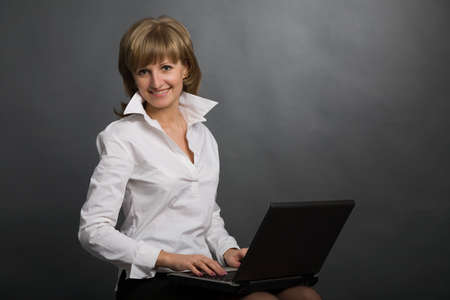 the young attractive woman with black laptop