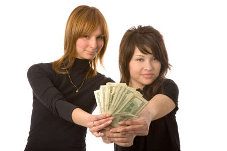 the two young women with money on white background photo