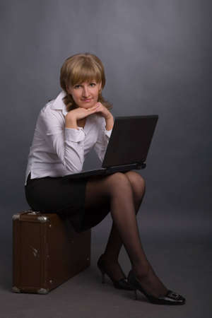 the young attractive woman with black laptop photo
