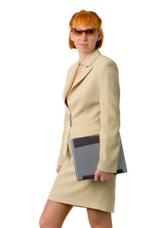 the young businesswoman with laptop on white background photo
