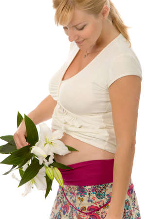 the pregnant woman with madonna lily on white background photo