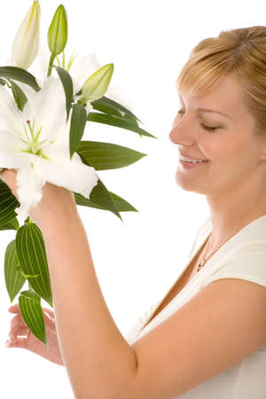 the young blond woman with madonna lily on white background photo