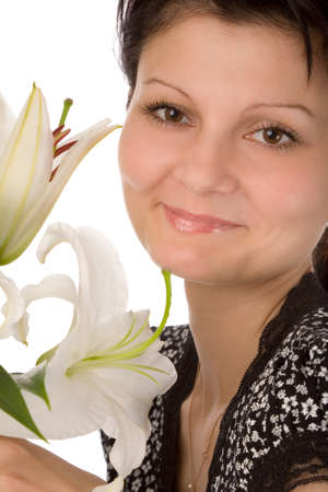 the young woman with madonna lily on white background photo