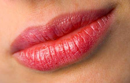 the female lips with cosmetics macro shot