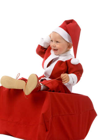 the small boy in christmas dress on white background photo
