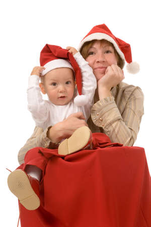 the son and mother in christmas dress on white background photo