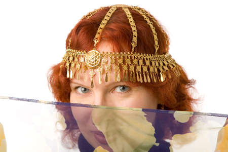 adornment: the young pretty woman with gold adornment Stock Photo