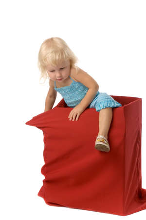 the small girl in red box on white background Stock Photo - 1886169