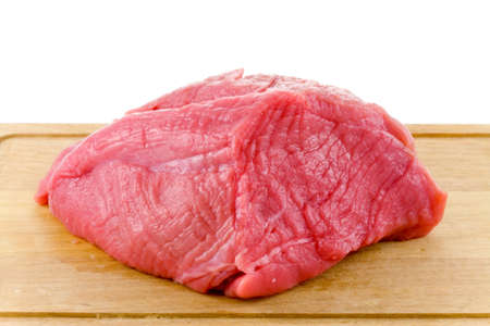 raw beef on wood board isolated on white background