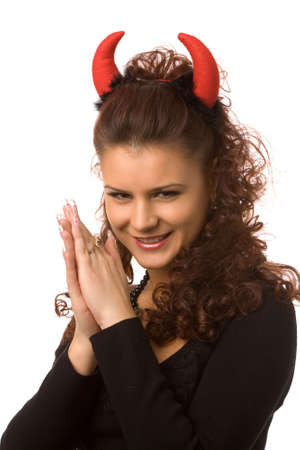 sexy devil: portrait of young woman dressed as pretty devil Stock Photo
