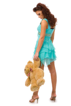 pretty woman with toy on white background photo