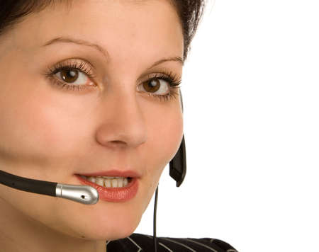 the young brunette woman with headset on white background photo