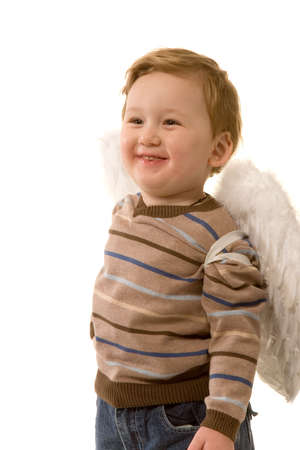 small merry boy dreessed as angel on white background photo
