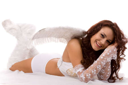 angel white: pretty woman dressed as angel on white background