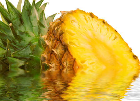 half of pineapple in water isolated on white background Stock Photo