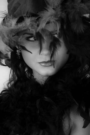 black plumage: young pretty woman in hat with plumage, black and white