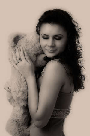 pretty woman with toy, black and white, sepia photo