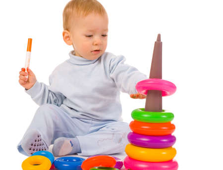small boy with toys on white background Stock Photo