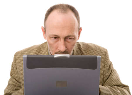 earnest: senior man with laptop on white background Stock Photo