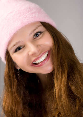 close-up portrait of young woman in pink cap photo