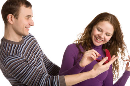 happy young couple on a white background Stock Photo - 2651230