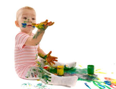 guache: pintura peque�a del aguazo del muchacho en el fondo blanco Foto de archivo