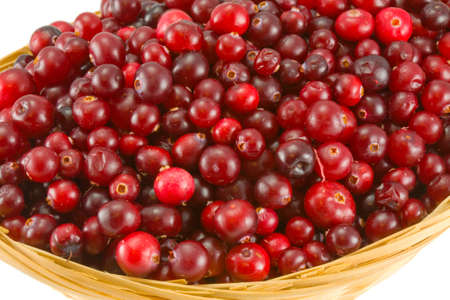 red cranberry in crib isolated on white background photo