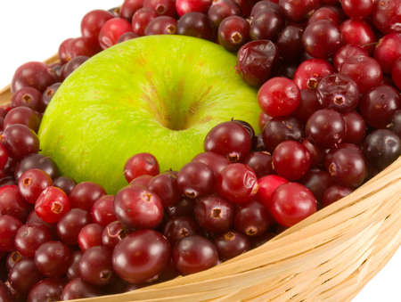 red cranberry and apple in crib isolated on white background photo