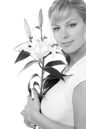 young woman with madonna lily, black and white photo