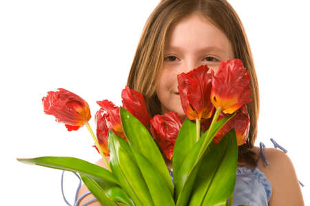 artificial hair: girl with artificial tulips on a white background Stock Photo