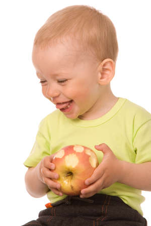 The little boy eats the big apple on a white background photo