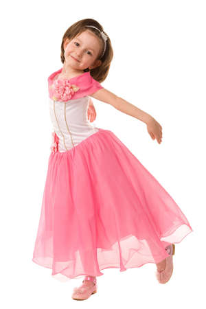 little girl in pink dress on a white background Stock Photo