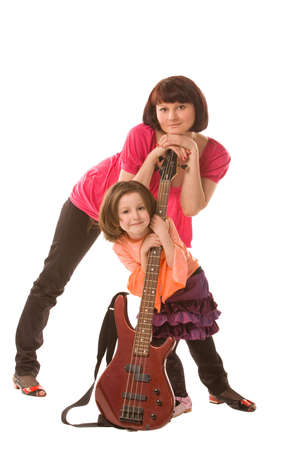 mother and daughter with electric guitar on a white background photo