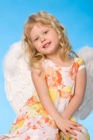 small girl dreessed as angel on blue background Stock Photo - 3224045