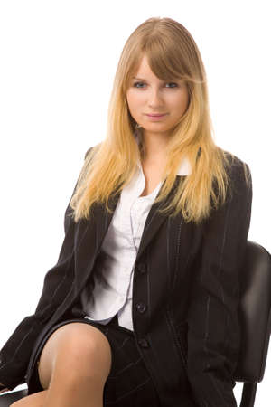 stern: young businesswoman to sit on chair, white background, isolated Stock Photo