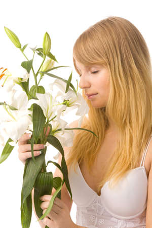 young woman with madonna lily on white background photo