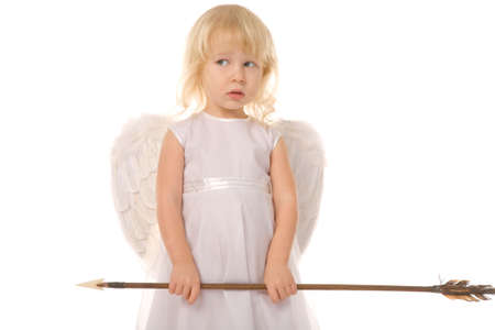 small girl with arrow dressed as angel on white background photo