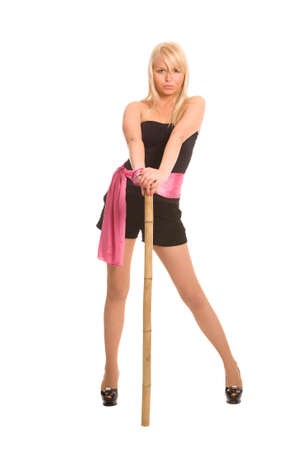 blond woman with bamboo staff on a white background photo