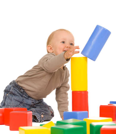 little boy play with bricks. isolated on a white background Stock Photo