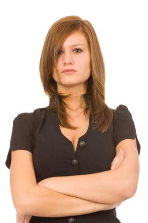 jeune femme grave sur un fond blanc  Banque d'images